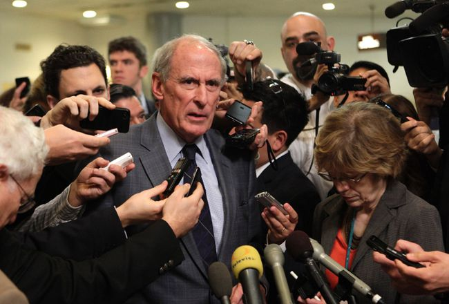 Sen. Dan Coats talks to the media in Washington in this November 16, 2012 file photo. (REUTERS/Yuri Gripas)