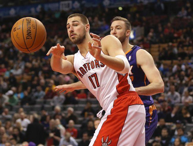 Toronto Raptors centre Jonas Valanciunas (17) passes the ball  against the Phoenix Suns at Air Canada Centre. The Suns beat the Raptors 121-113 on Mar 16, 2014 in Toronto, Ontario, CAN. (Tom Szczerbowski/USA TODAY Sports)