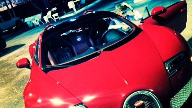 Justin Bieber posing with the $2 million Bugatti Birdman gifted to him.   (Instagram/JustinBieber)