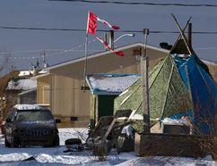 A tattered Canadian flag flies over a teepee in Attawapiskat, Ontario, December 17, 2011. (REUTERS FILE PHOTO/Frank Gunn/Pool)