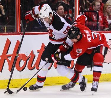 Ottawa Senators' Marc Methot battles with New Jersey Devils' Jaromir Jagr during NHL hockey action at the Canadian Tire Centre in Ottawa, Ontario on Thursday April 10, 2014. Errol McGihon/Ottawa Sun/QMI Agency