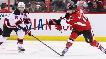Ottawa Senators' Clarke McArthur fires a shot past New Jersey Devils' Andy Greene during NHL hockey action at the Canadian Tire Centre in Ottawa, Ontario on Thursday April 10, 2014. Errol McGihon/Ottawa Sun/QMI Agency