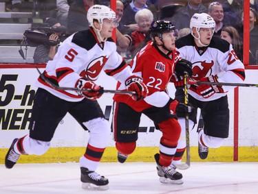 Ottawa Senators' Erik Condra battles with New Jersey Devils' Adam Larsson (L) and Anton Volchenkov during NHL hockey action at the Canadian Tire Centre in Ottawa, Ontario on Thursday April 10, 2014. Errol McGihon/Ottawa Sun/QMI Agency