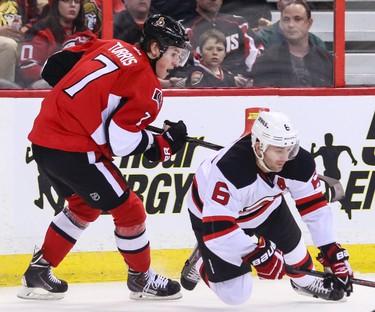 Ottawa Senators' Kyle Turris trips up New Jersey Devils' Andy Greene during NHL hockey action at the Canadian Tire Centre in Ottawa, Ontario on Thursday April 10, 2014. Errol McGihon/Ottawa Sun/QMI Agency