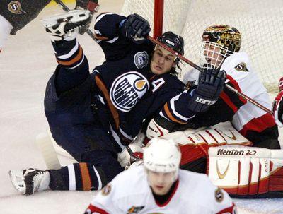 March 14, 2004. Edmonton Oilers Ryan Smyth (left) falls into Ottawa Senators goalie Martin Prusek during first period NHL action in Edmonton, Alta., Sunday March 14, 2004. Edmonton Sun/QMI Agency