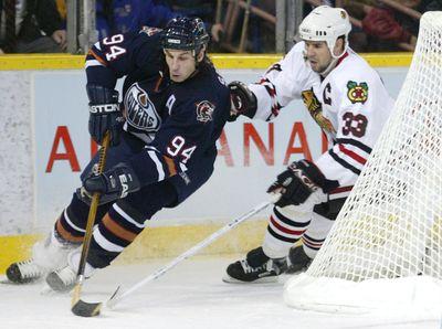 November 19, 2005. Edmonton Oilers Ryan Smyth battles Chicago Blackhawks Adrian Aucoin during first period NHL action at Rexall Place in Edmonton, Alta., on Saturday November 19, 2005.  Edmonton Sun/QMI Agency
