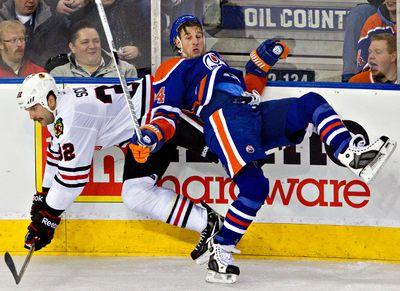 November 19, 2011. Edmonton Oilers Ryan Smyth collides with Chicago Blackhawks John Scott during third period NHL action at Rexall Place in Edmonton, Alberta on Saturday, November 19, 2011. The Oilers won 9-2. Amber Bracken/Edmonton Sun/QMI Agency