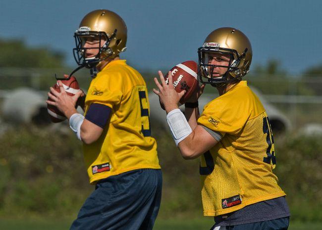 Winnipeg Blue Bombers quarterbacks Drew Willy, left, and Max Hall throw during training camp at IMG Academies in Bradenton, Florida on Sunday, April 13, 2014. (Steve Nesius/QMI Agency)