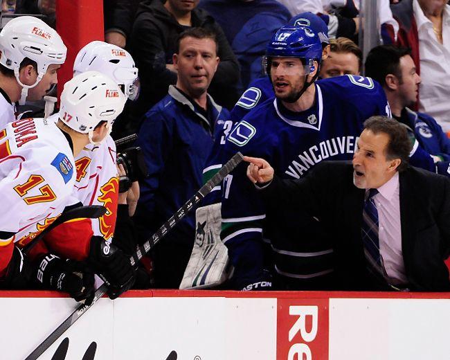 Canucks coach John Tortorella and Flames coach Bob Hartley still don't like each other. (REUTERS)