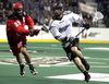 Rush player Zack Greer battles Roughnecks' Andrew McBride at Rexall Place Jan. 17. (David Bloom, Edmonton Sun)