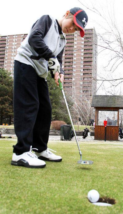 Golfer Nolan Horne, 11, at  Dentonia Park golf course on Friday. (VERONICA HENRI)