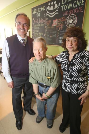 Clive stands between Larry and Tova Vickar at L'Arche Tova Cafe in Winnipeg.    Thursday, April 17, 2014.   Chris Procaylo/Winnipeg Sun/QMI Agency