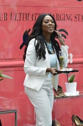 "Kenya Moore is pictured filming on the ""Celebrity Apprentice"" set in Central Park, New York. (TNYF/WENN.COM)"