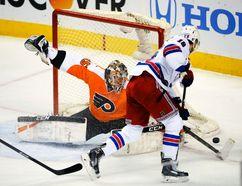 Philadelphia Flyers goalie Steve Mason makes a save against New York Rangers centre Derick Brassard during Game 4 of their Eastern Conference quarterfinal series at the Wells Fargo Center in Philadelphia, April 25, 2014. (ERIC HARTLINE/USA Today)