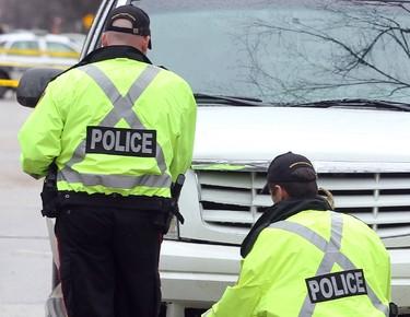 Winnipeg Police investigate following a serious collision between a Cadillac SUV and a pedestrian at Grosvenor and Wilton in Winnipeg, Man. Monday April 28, 2014. Brian Donogh/Winnipeg Sun/QMI Agency