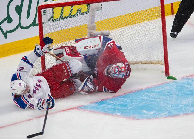 Rangers centre Chris Kreider slides into Habs goalie Carey Price during Game 1 Saturday night. (QMI Agency)