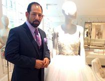 Wedding dress designer Lazaro Perez stands next to one of his creations at Kleinfeld Hudson's Bay. (Rosalyn Solomon/QMI Agency)