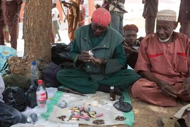 A man makes homemade bullets at a camp of a vigilante group of traditional hunters in Maiduguri May 21,  2014. REUTERS/Joe Penney