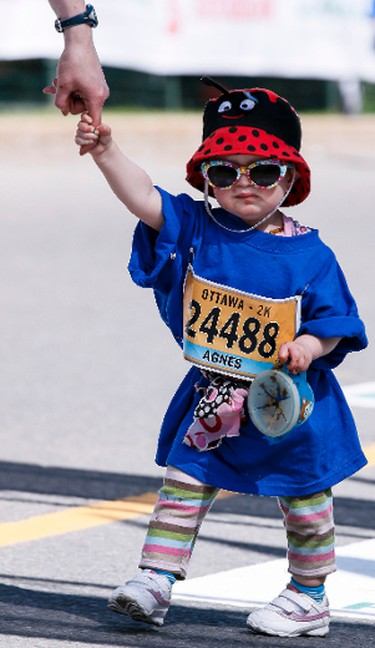 Agnes Morris crosses the finish line in the Ottawa 2K on Saturday May 24, 2014. Errol McGihon/Ottawa Sun/QMI Agency