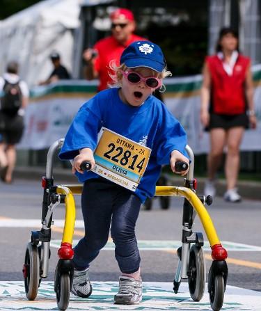 Olivia Schuler finishes the Ottawa 2K on Saturday May 24, 2014. Errol McGihon/Ottawa Sun/QMI Agency