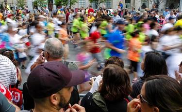 Runners are blurred in the mass start of the Ottawa 5K on Saturday May 24, 2014. Errol McGihon/Ottawa Sun/QMI Agency
