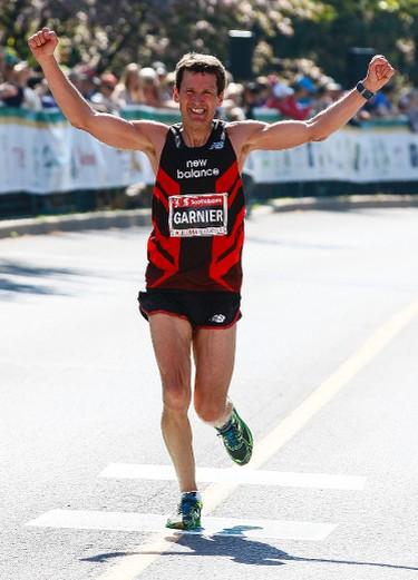 Louis-Philippe Garnier celebrates as he approaches the finish line of the Scotiabank Ottawa Marathon on Sunday May 25, 2014. Errol McGihon/Ottawa Sun/QMI Agency