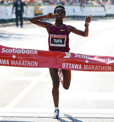 Tigist Tufa of Ethiopia was the first woman to cross the finish line in a time of 2:24:31 in the Scotiabank Ottawa marathon on Sunday May 25, 2014. Errol McGihon/Ottawa Sun/QMI Agency