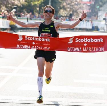 was the first Canadian man to cross the finish line in the Scotiabank Ottawa Marathon on Sunday May 25, 2014. Errol McGihon/Ottawa Sun/QMI Agency