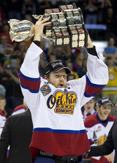 Edmonton Oil Kings captain Griffen Reinhart hoists the the Memorial Cup after defeating the Guelph Storm 6-3.  DEREK RUTTAN/ The London Free Press /QMI AGENCY