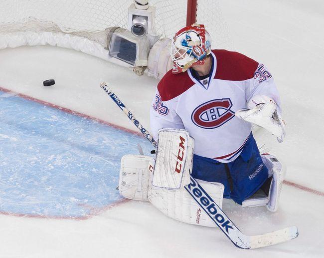 Canadiens goalie Dustin Tokarski allows the OT game-winner to the Rangers' Martin St. Louis in Game 4. (Ben Pelosse/QMI Agency)