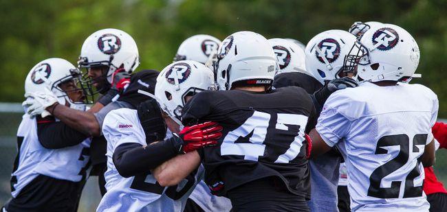 RedBlacks players scrimmage yesterday during rookie camp at Keith Harris Stadium. (Errol McGihon/Ottawa Sun)