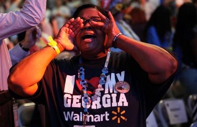 A Walmart employee shouts during the Walmart U.S. associates meeting in Fayetteville, Arkansas June 4, 2014. The meeting was part of Walmart's annual shareholder meeting. (REUTERS/Rick Wilking)