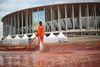 A worker cleans outside the Mane Garrincha National Stadium ahead of the 2014 World Cup, in Brasilia June 5, 2014. (REUTERS/Ueslei Marcelino)