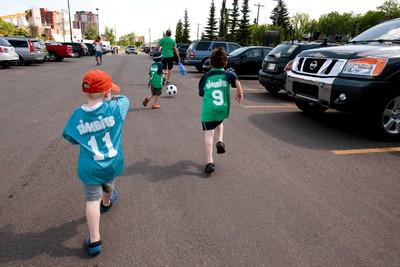 Kids wearing Timbits soccer jerseys head home after an NASL soccer game between FC Edmonton and the Carolina RailHawks at Clarke Stadium in Edmonton, Alta., Sunday June 8, 2014. Final score was 6-1 for the Eddies. Ian Kucerak/Edmonton Sun/QMI Agency