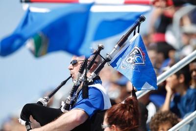 An Edmonton fan plays the bagpipes during an NASL soccer game between FC Edmonton and the Carolina RailHawks at Clarke Stadium in Edmonton, Alta., Sunday June 8, 2014. Final score was 6-1 for the Eddies. Ian Kucerak/Edmonton Sun/QMI Agency