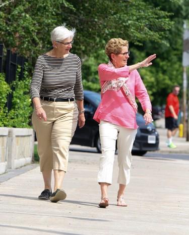 Premier Kathleen Wynne heads down Mount Pleasant Rd with her partner Jane to vote, in Toronto on Thursday, June 12, 2014. Veronica Henri/Toronto Sun/QMI Agency