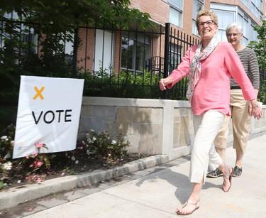 Premier Kathleen Wynne heads down Mount Pleasant Rd with her partner Jane to vote,in Toronto on Thursday, June 12, 2014. Veronica Henri/Toronto Sun/QMI Agency