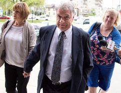 Mayor Joe Fontana is accompanied by his wife Vicky as he walks to the courthouse London, Ont. DEREK RUTTAN/QMI AGENCY