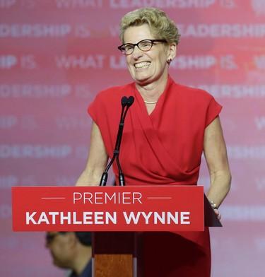 Liberal Leader Kathleen Wynne celebrates the Liberal party's majority re-election on Thursday, June 12, 2014. (CRAIG ROBERTSON/Toronto Sun)