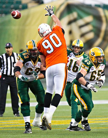 Edmonton's quarterback Matt Nichols (16) as B.C.'s Rob Lohr (90) tries to intercept during the second half of the Edmonton Eskimos' pre-season CFL football game against the B.C. Lions at Commonwealth Stadium in Edmonton, Alta., on Friday, June 13, 2014. Codie McLachlan/Edmonton Sun/QMI Agency