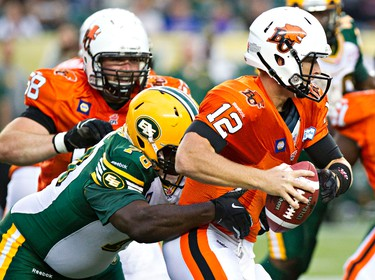 Edmonton's Ra'Shon Harris (78) sacks B.C.'s quarterback John Beck (12) during the second half of the Edmonton Eskimos' pre-season CFL football game against the B.C. Lions at Commonwealth Stadium in Edmonton, Alta., on Friday, June 13, 2014. Codie McLachlan/Edmonton Sun/QMI Agency
