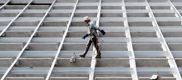Crews work on a building under construction along Fort Road near 137 Avenue, in Edmonton Alta., on Thursday June 12, 2014. David Bloom/Edmonton Sun/QMI Agency