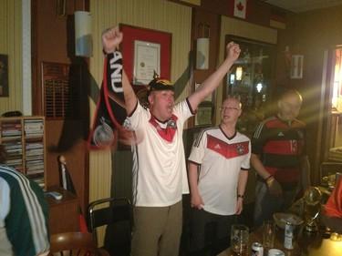 German fan Rob Schaepe (left) celebrates at the German Club on Charles Street in Winnipeg on June 16, 2014. Germany beat Portugal 4-0 in World Cup action in Brazil. (DAVID LARKINS/WINNIPEG SUN/QMI AGENCY)