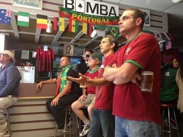 Portuguese soccer fans watch nervously at the Bomba Club in Winnipeg on June 16, 2014. Germany beat Portugal 4-0 in World Cup action in Brazil. (DAVID LARKINS/WINNIPEG SUN/QMI AGENCY)