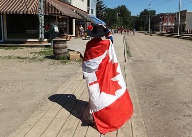 Daniel Ziemann, 10, walks down 1905 boardwalk as he takes in the Dominion Day Celebrations at Fort Edmonton Historical Park, in Edmonton, Alta., Monday July 1, 2013. David Bloom/Edmonton Sun/QMI Agency
