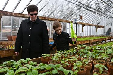 Julia Ratke, left, and Andrew Baldt, 9, visit a greenhouse during Easter celebrations at Fort Edmonton Park in Edmonton, Alta., on Sunday, April 20, 2014. Codie McLachlan/Edmonton Sun/QMI Agency