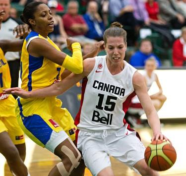 Canada's Michelle Plouffe, right, fends off Brazil's Karina Jacob during the Edmonton Grads International Classic basketball tournament at the Saville Community Sports Centre in Edmonton, Alta., on Thursday, June 26, 2014. Codie McLachlan/Edmonton Sun/QMI Agency