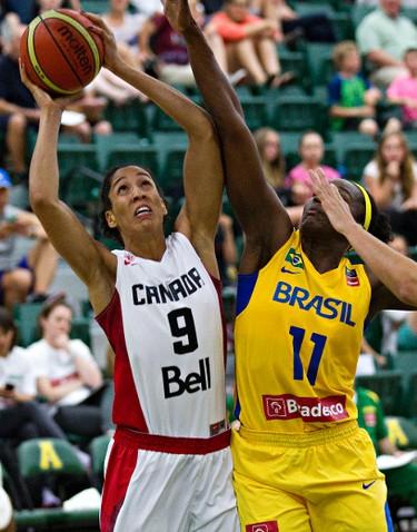 Canada's Miranda Ayim, left, takes a shot as Brazil's Clarissa Santos defends during the Edmonton Grads International Classic basketball tournament at the Saville Community Sports Centre in Edmonton, Alta., on Thursday, June 26, 2014. Codie McLachlan/Edmonton Sun/QMI Agency