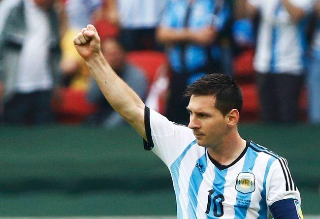 Argentina's Lionel Messi celebrates his second goal during the 2014 World Cup Group F soccer match against Nigeria at the Beira Rio stadium in Porto Alegre June 25, 2014 (REUTERS/Stefano Rellandini)