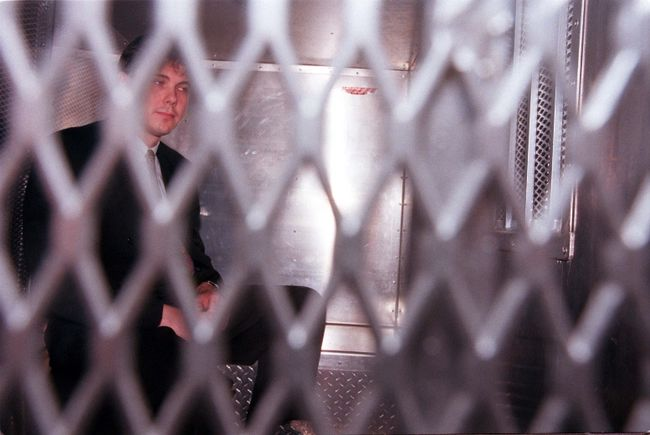 Paul Bernardo leaves court in police van.